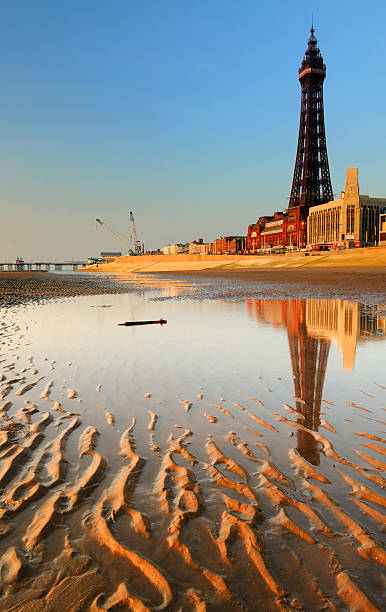 Blackpool Seafront The iconic Blackpool tower reflected in water on the famous Golden Mile beach. XL image size. northwest england stock pictures, royalty-free photos & images