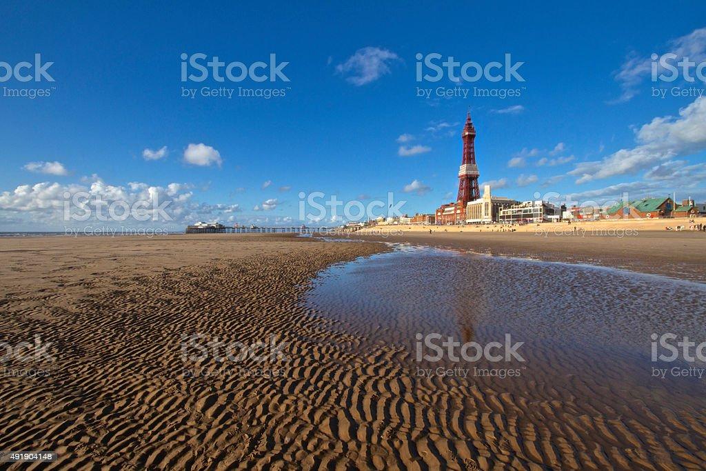 Blackpool Tower, Beach and Blue Sky stock photo