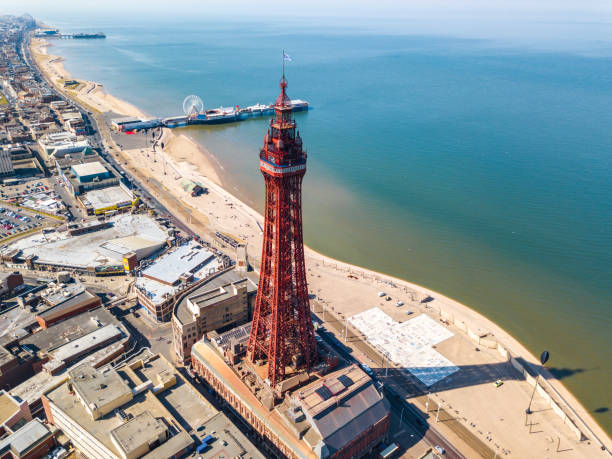 Blackpool tower in Blackpool, UK An aerial view of the Blackpool Tower with the Central pier in the background located in Blackpool, UK northwest england stock pictures, royalty-free photos & images