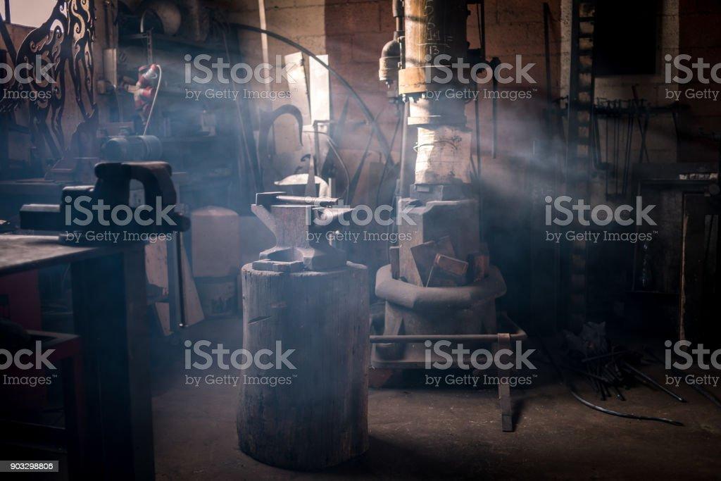 Blacksmith artist smithy studio laboratory stock photo