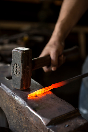 istock blacksmith at forge 547228252