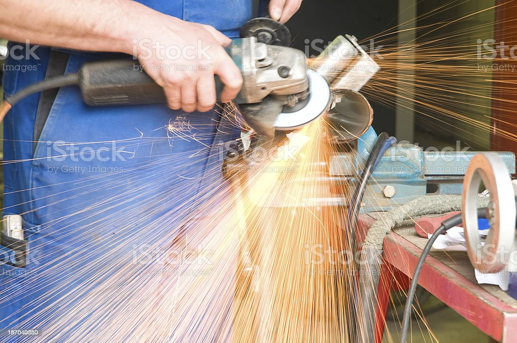Blacksmith at work, grinding stock photo