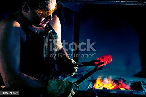 istock Blacksmith at work 155150623