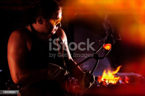 istock Blacksmith at work 155388677