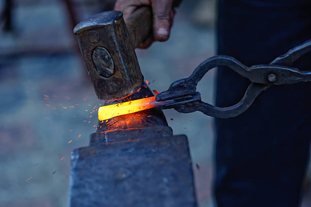 blacksmith at work  anvil stock pictures, royalty-free photos & images
