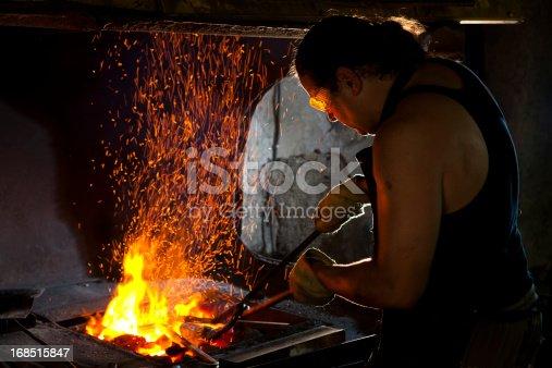 istock Blacksmith at work 168515847