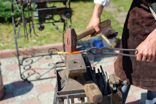 1130936245 istock photo blacksmith at work 176005239