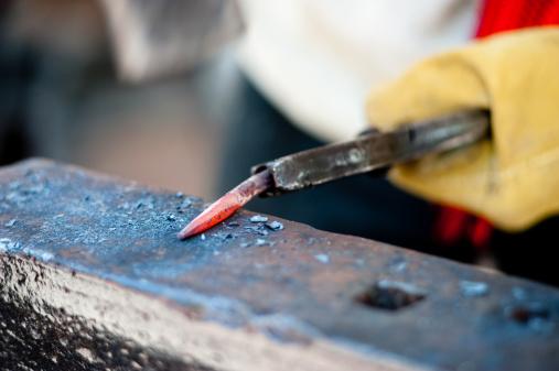 1130936245 istock photo blacksmith at work 176006019