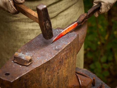 547224670 istock photo Blacksmith forges iron 479746332