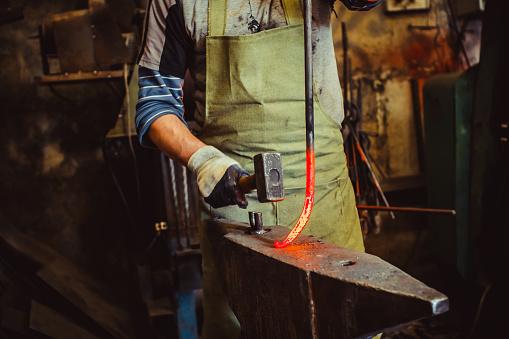 istock blacksmith hammer anvil 877010310