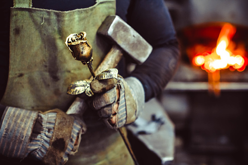 Blacksmith holding forged rose