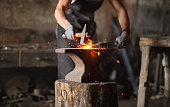 istock Blacksmith manually forging the molten metal 1155050689