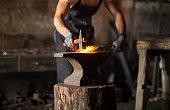 istock Blacksmith manually forging the molten metal 1155050768