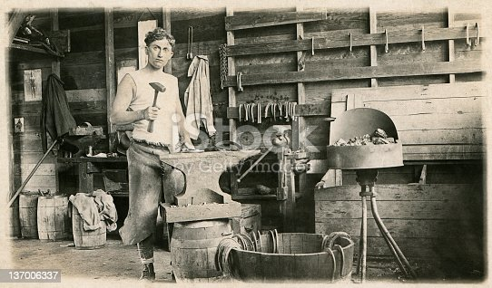A 1914 photograph of a young blacksmith working in his shop - Fort Riley, Kansas, 12th Calvary. NOTE TO INSPECTOR: photo passed down in our family.