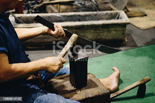 istock Blacksmith, Professional knife hit knife or sword 1065814102