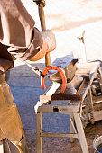 Blacksmith shapes a horseshoe