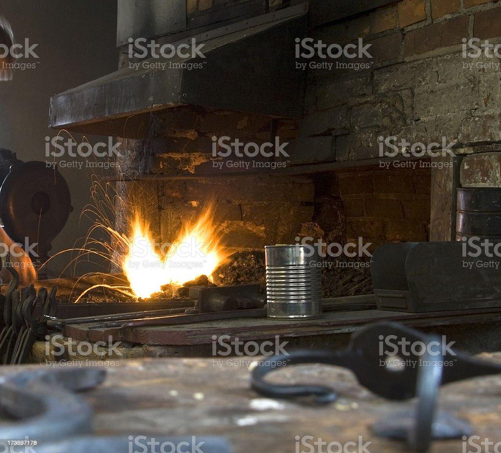 Blacksmith shop with sparks stock photo