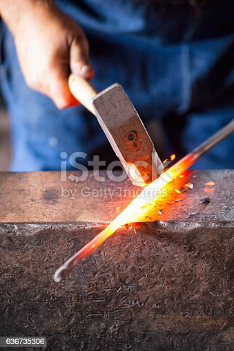istock Blacksmith Striking Hot Metal 636735306