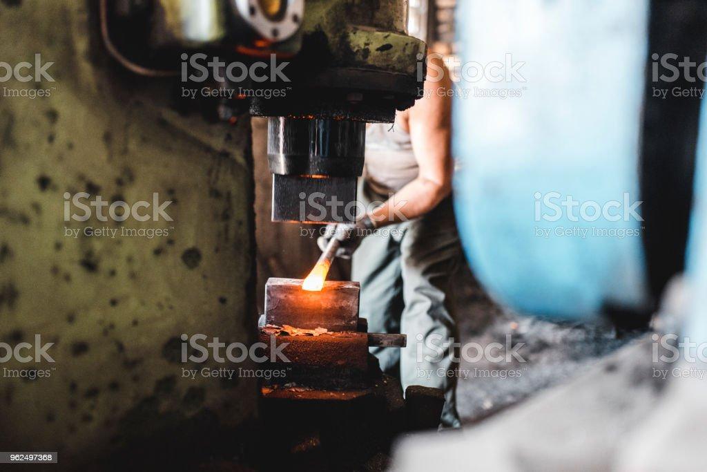 Blacksmith working in his metal workshop - Royalty-free 30-39 Years Stock Photo