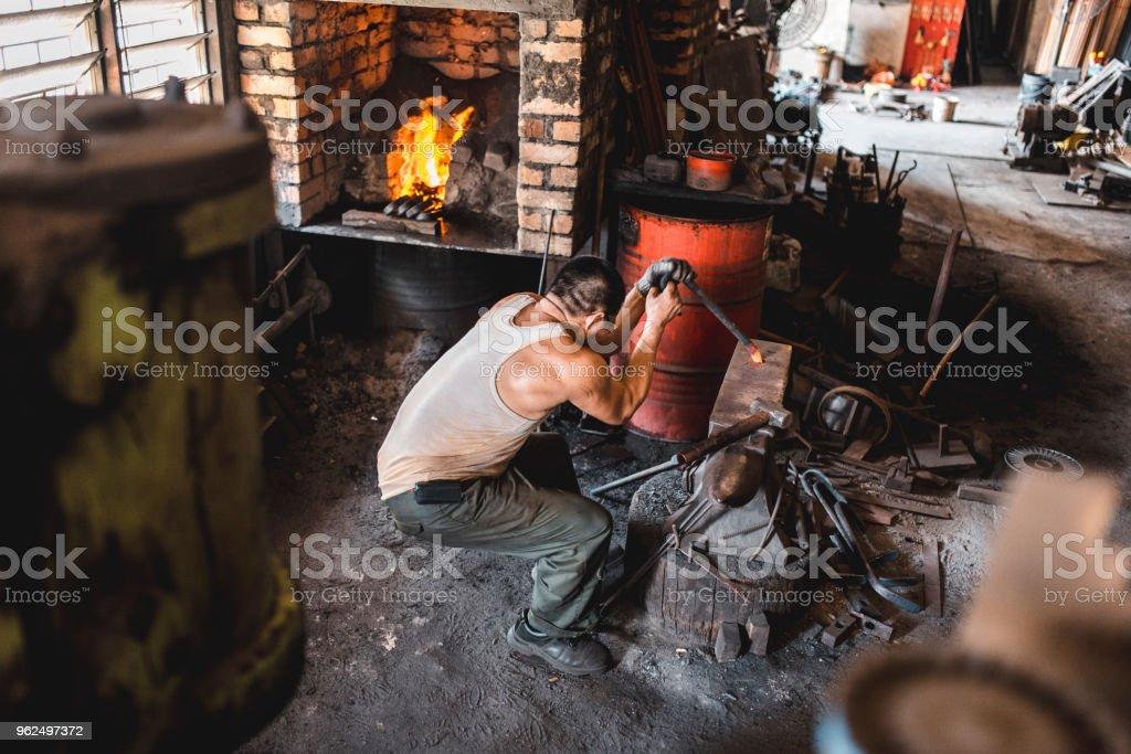 Blacksmith working in his metal workshop - Royalty-free 40-49 Years Stock Photo