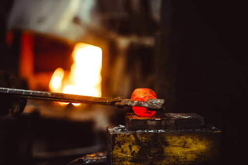 istock blacksmith working in the forge 877715422