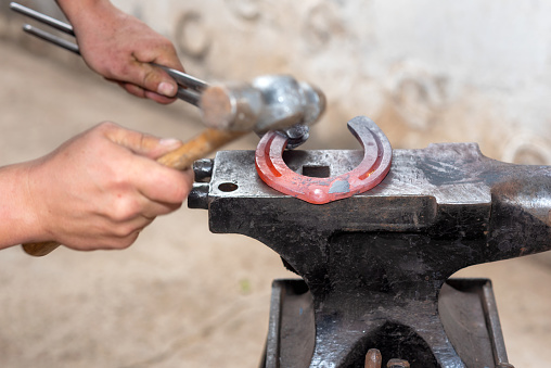 547224670 istock photo Blacksmith working on the anvil, making a horseshoe. 1132747227