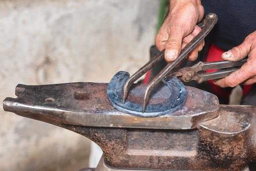 547224670 istock photo Blacksmith working on the anvil, making a horseshoe. 1132747518