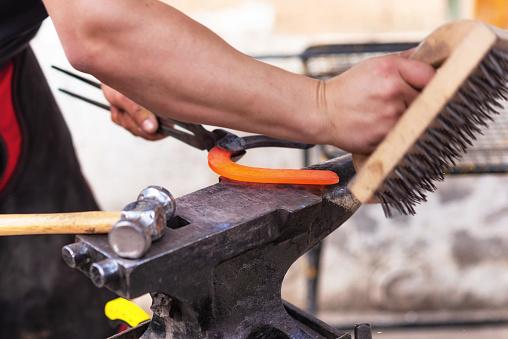 547224670 istock photo Blacksmith working on the anvil, making a horseshoe. 1132748748