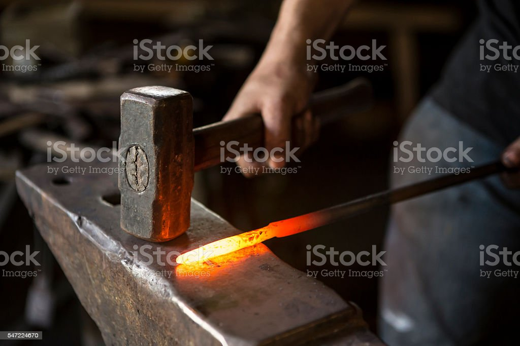 blacksmith working stock photo