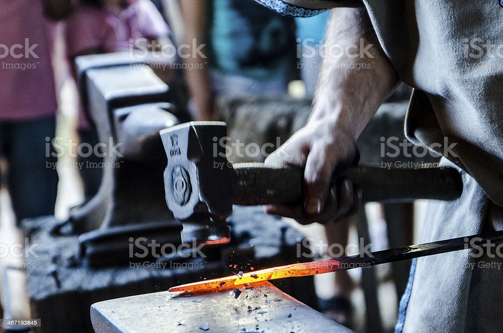 Blacksmith working red hot metal an anvil and hammer stock photo