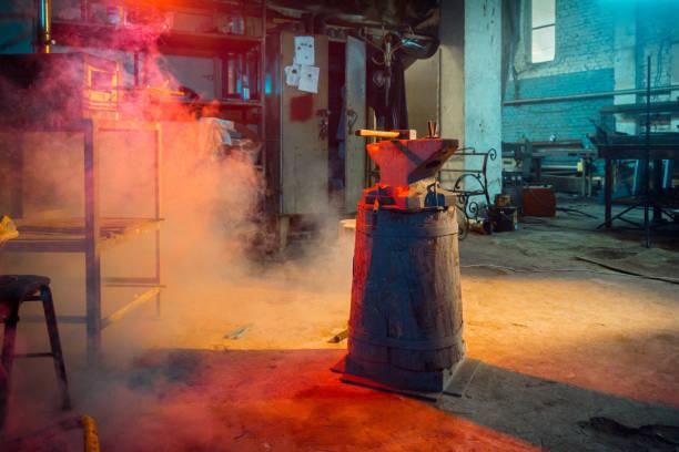 Blacksmith Workshop Shooting at dark blacksmith workshop anvil stock pictures, royalty-free photos & images