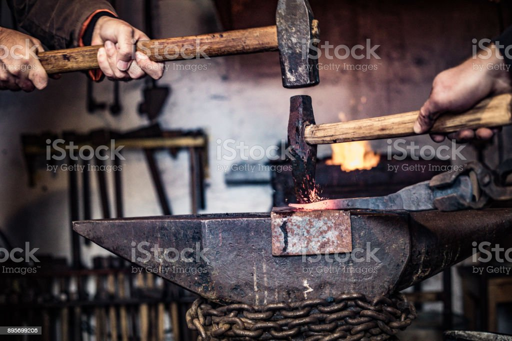 Blacksmiths Designing Knife Handle in a Forge stock photo