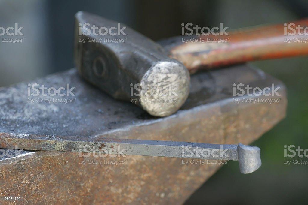 Blacksmith's Hammer and Iron royalty-free stock photo