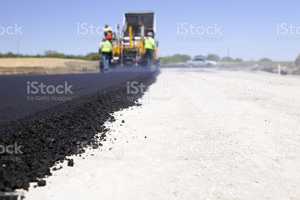 Blacktop Paving Road with Paver and Dump Truck stock photo