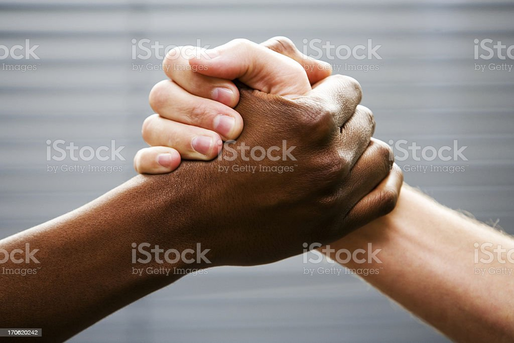 Black-white arm wrestling stock photo