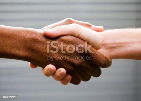 istock Black-white handshake 134955210