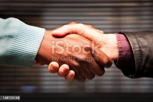 istock Black-white handshake 148124149