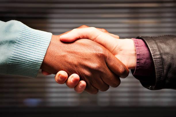 Black-white handshake stock photo
