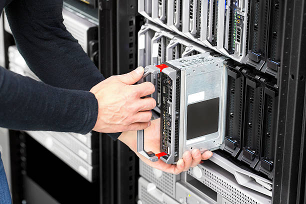 Blade server installation in large datacenter stock photo