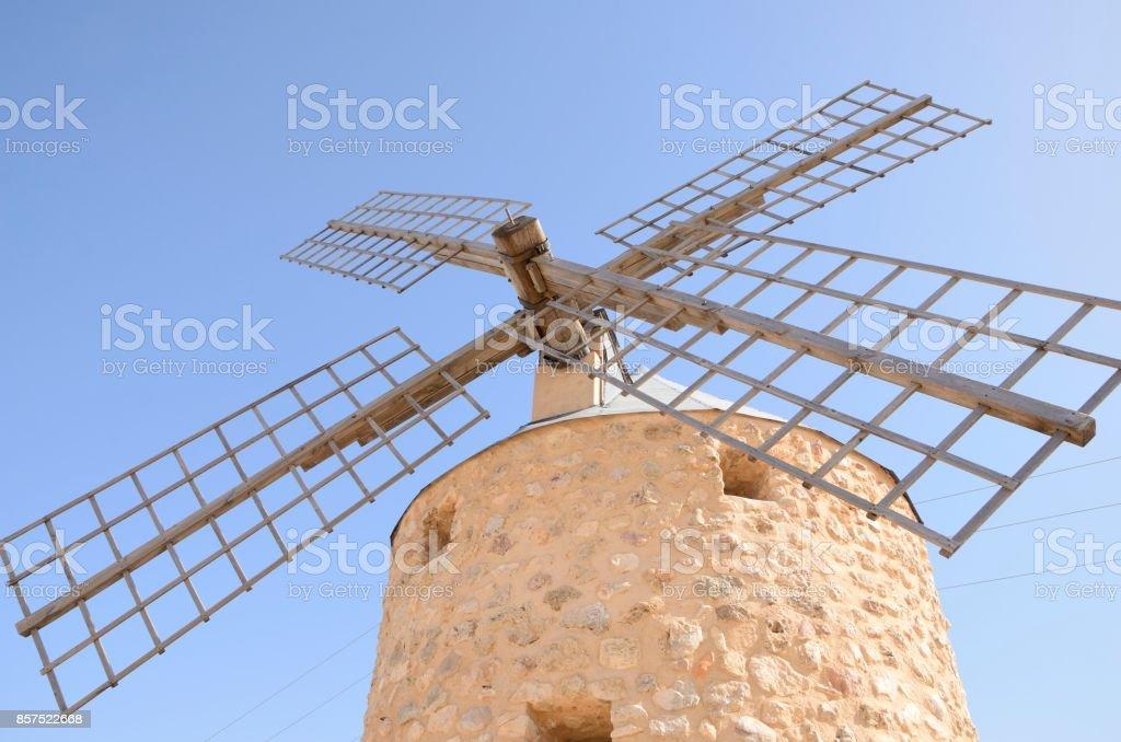 Blades of stone windmill stock photo