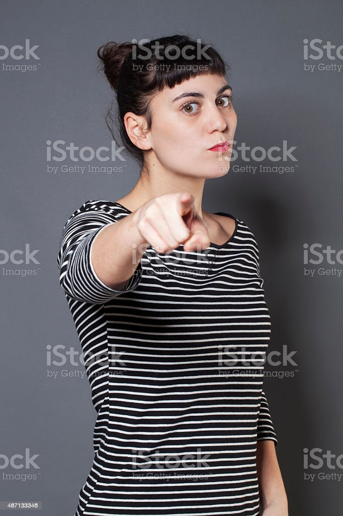 blaming 20s woman threatening someone with confidence stock photo