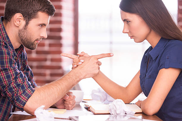 blaming each other. - battle of the sexes concept stock pictures, royalty-free photos & images