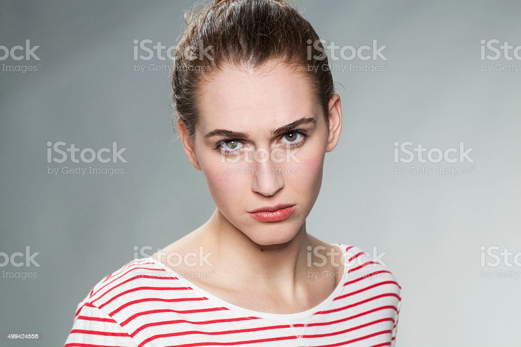 blaming young woman expressing disagreement and reproach with her face stock photo