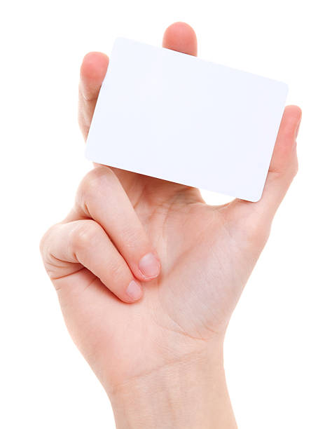 blanc card in female hand on white - gift voucher or card stock photos and pictures