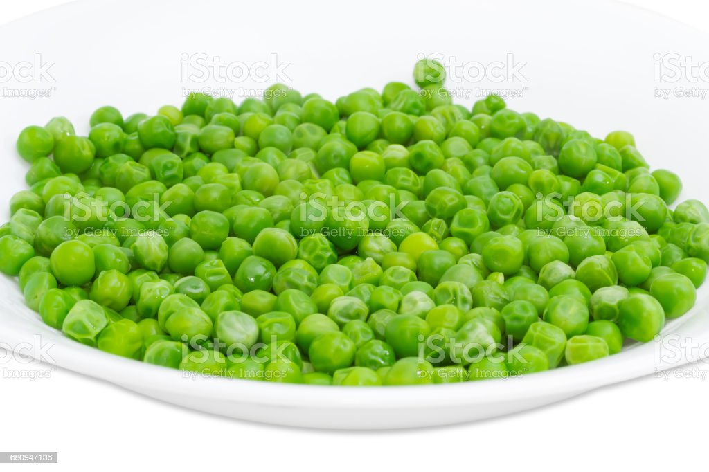 Blanched green peas in white dish closeup royalty-free stock photo