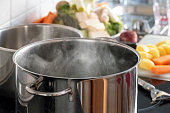 istock Blanching vegetables in big cooking pot preparation 945022736