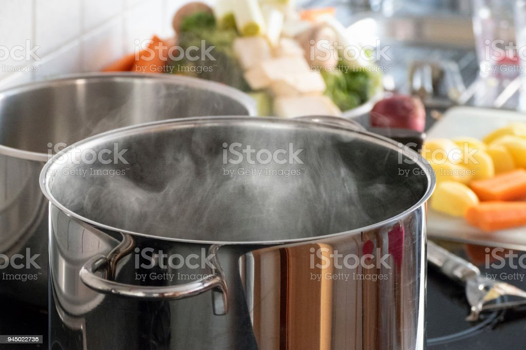 Blanching vegetables in big cooking pot preparation stock photo