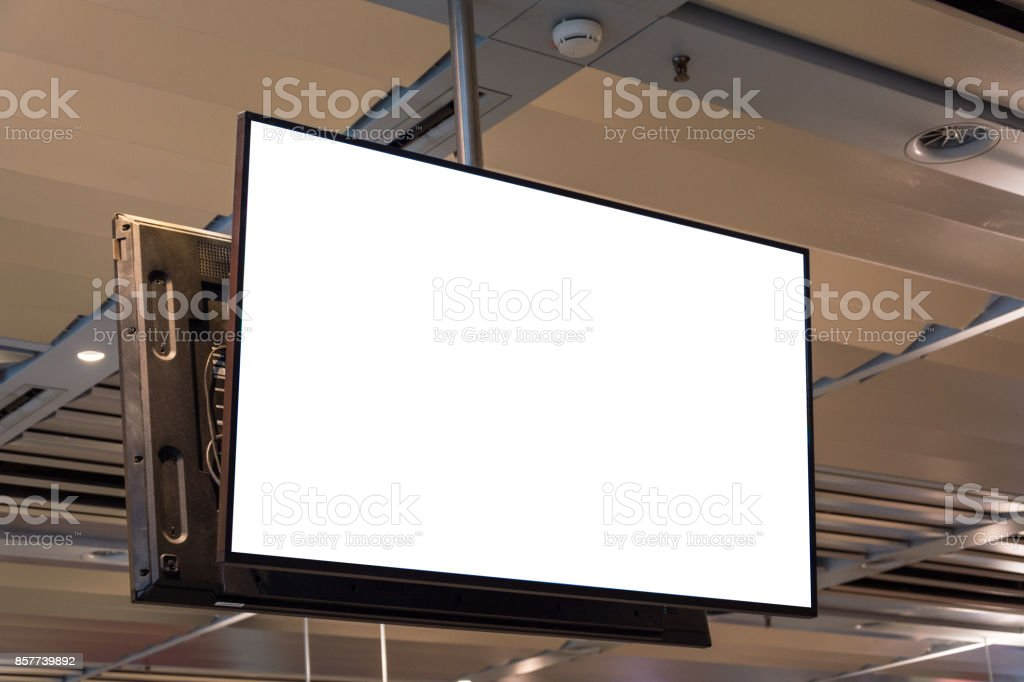 Blank ad space screen hanging from the ceiling close up stock photo