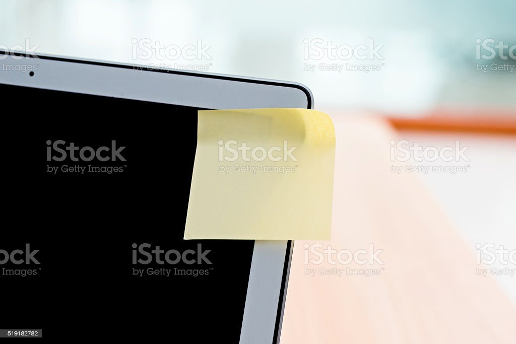 Blank adhesive note on laptop stock photo