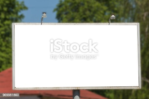 istock Blank advertisement board on the street of the city. 969981860